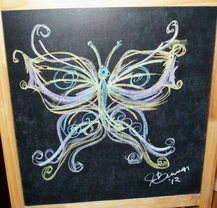 Picture of astylized chalk drawing of a butterfly on a chalkboard created by Jennifer Benner